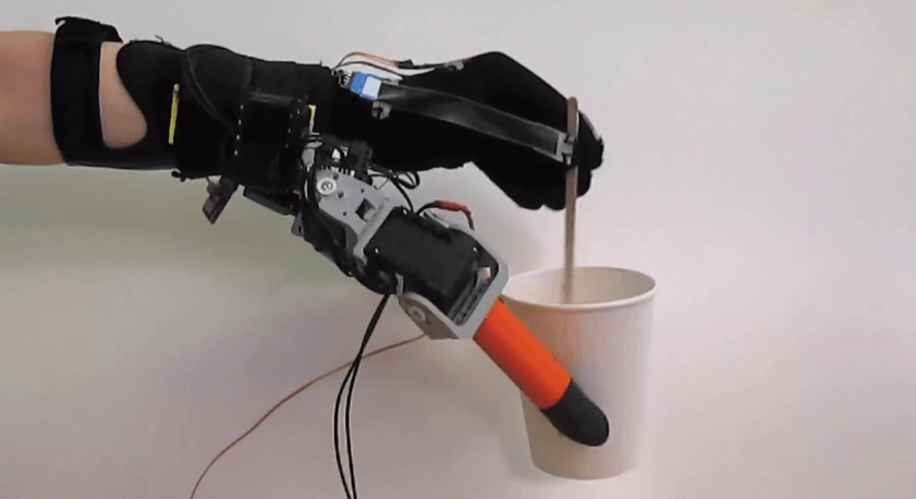 7 finger robotic mount stirring mug of tea with one hand